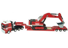 MAN LOW LOADER TRUCK with EXCAVATOR