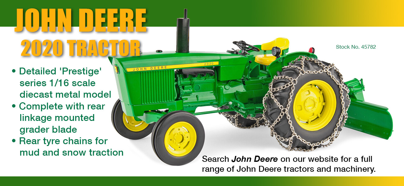 John Deere 2010 utility tractor with mounted grader blade